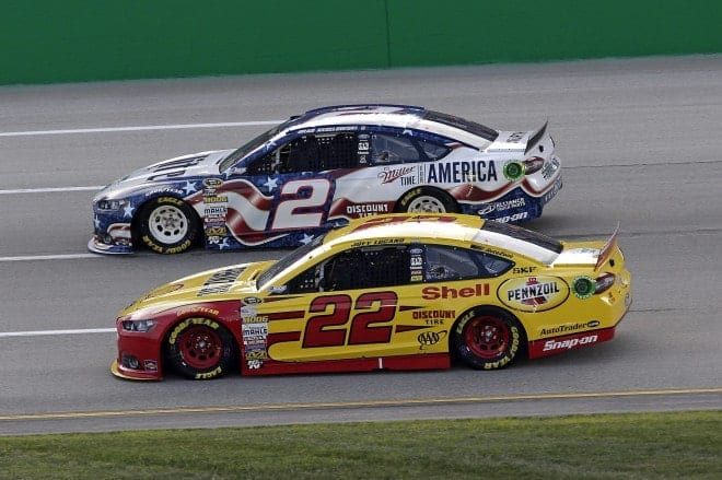 Joey Logano races alongside Brad Keselowski at Kentucky Speedway on June 28. (Credit: CIA)
