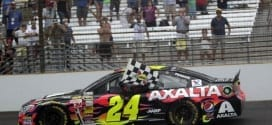 Jeff Gordon carries the checkered flag after winning the 2014 Brickyard 400 at Indianapolis. (Credit: CIA)