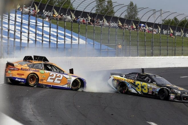 Joey Logano and Morgan Shepherd spin at New Hampshire Motor Speedway. (Credit: CIA)