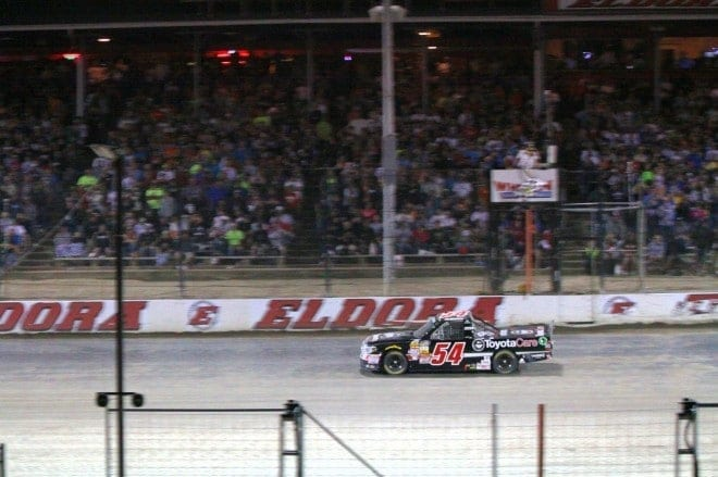 Darrell Wallace Jr. passes under the checkered flag to claim the Mudsummer Classic  Credit: Mike Neff