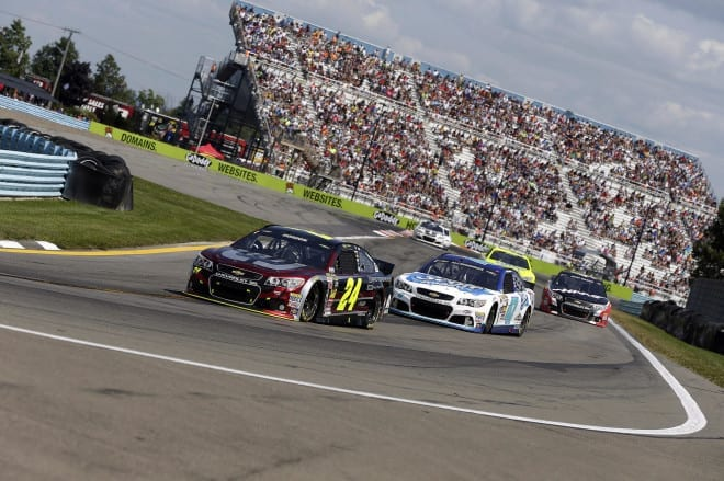 Jeff Gordon leads a pack of cars in the 2014 Cheez-It 355 at the Glen at Watkins Glen, NY