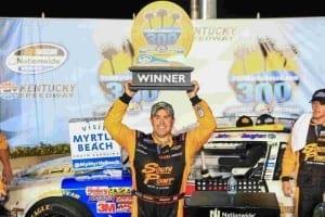 2014 Kentucky II NNS Brendan Gaughan trophy credit NASCAR via Getty Images