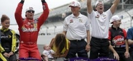 Kyle Busch and his Joe Gibbs Racing team celebrate after winning at Indianpolis Motor Speedway