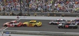Kyle Busch crosses the finish line in the Jeff Kyle 400 at the Brickyard at Indianapolis Motor Speedway