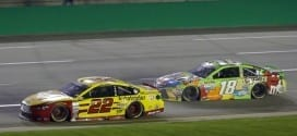 Joey Logano races with Kyle Busch during the Quaker State 400 at Kentucky Speedway.