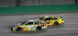 Kyle Busch and Joey Logano race for position in the Quaker State 400 at Kentucky Speedway.