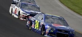 Jeff Gordon leads a pack of NASCAR Sprint Cup drivers in the Pure Michigan 400 at Michigan International Speedway