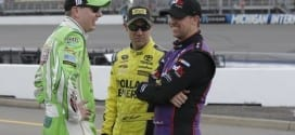 Kyle Busch, Matt Kenseth and Denny Hamlin compare notes before the Pure Michigan 400 at Michigan International Speedway
