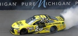Matt Kenseth poses with the trophy after winning the Pure Michigan 400 at Michigan International Speedway