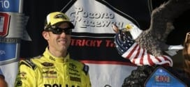 Matt Kenseth poses with the Windows 10 400 winner's trophy in Victory Lane at Pocono Raceway