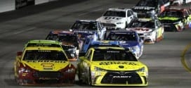 Matt Kenseth leads the NASCAR Sprint Cup field to a restart during the 2015 Federated Auto Parts 400 at Richmond International Speedway